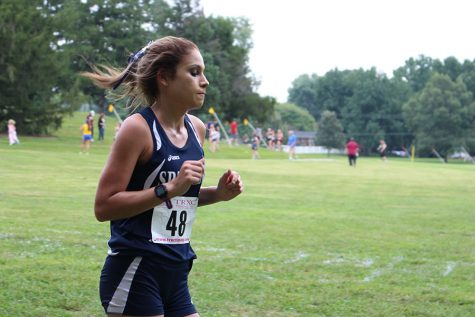 Girls cross country overcome obstacles