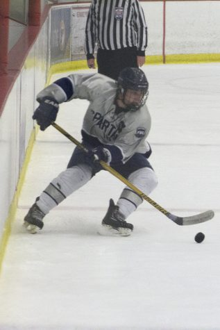 Varsity Hockey Shoots Short
