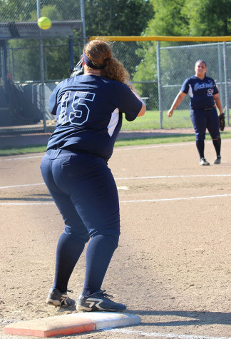 Satiah Duval prepares to catch a throw to first base to make the out.