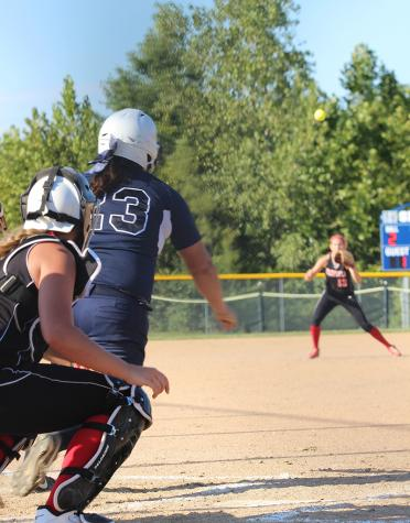 Senior Kaylee Sheridan watches the ball fly after hitting a line drive against Winfield.