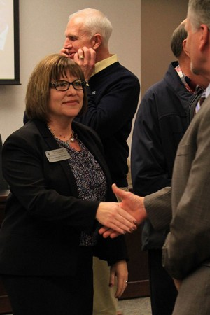 Newly named superintendent Mary Hendricks-Harris shakes hands with human resource officer Dr. Steve Griggs on Thursday, Feb. 4. Dr. Henricks-Harris is currently the chief academic officer in the district and beat out two other finalists for the position and will assume the office on July 1.