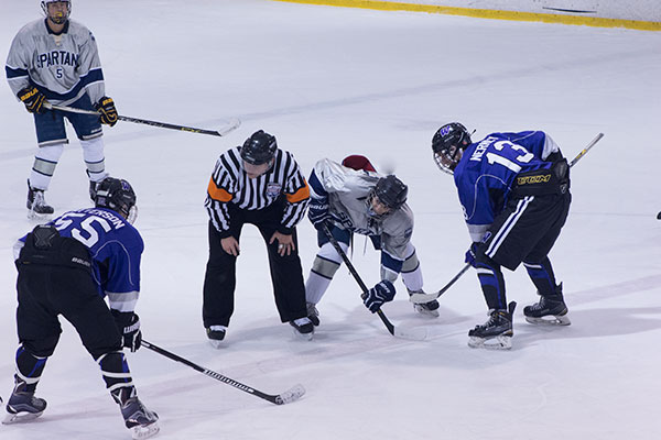 Spartans at the puck off. They won 8-6 against Holt on Tuesday night.