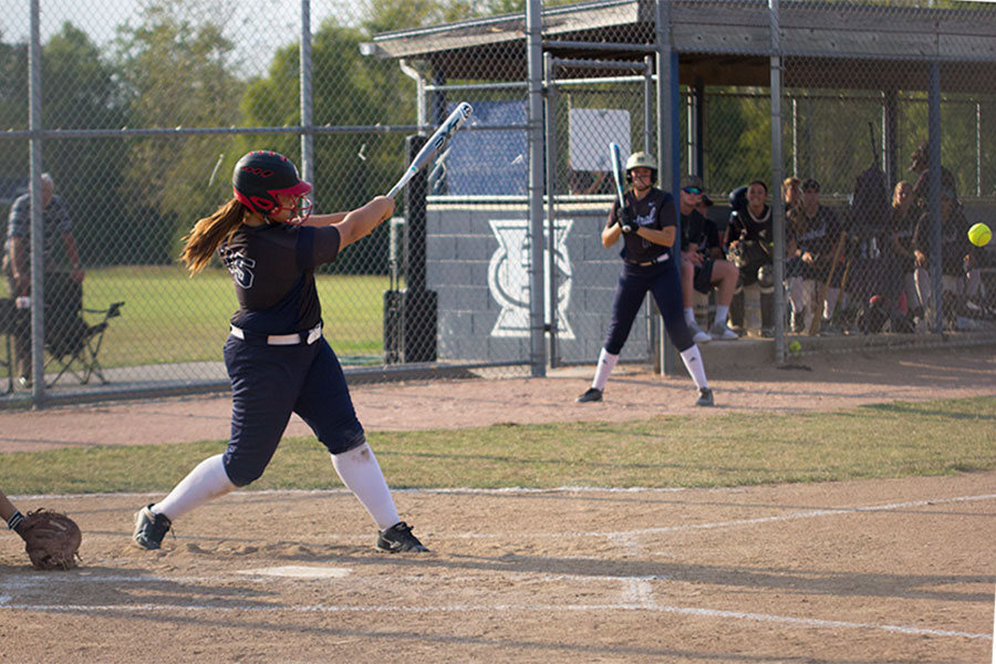A+member+of+the+varsity+softball+team+nails+an+incoming+ball+into+the+outfield.+The+team%27s+talent+in+batting%2C+especially+from+senior+Kaitlyn+Chadwick%2C+will+help+enormously+to+overcome+Troy+later+in+the+season.