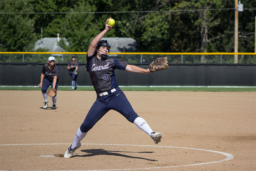 Pitcher Alyssa Kolkmeyer, junior, lobs a fastball to a FZW batter at their last districts game. The team played to their max, but wasn't able to overcome FZW's equally powerful skill.