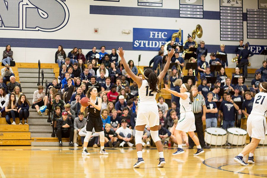 Junior+Yani+Curry+%28%2312%29+locks+down+a+defensive+line+with+fellow+senior+guard+Makenzie+Schierding+%28middle%29+against+the+FZS+Bulldogs.+The+varsity+girls%27+team+is+known+for+their+shock-and-awe+playing+tactics%2C+but+have+been+working+on+building+strong+defenses+for+the+second+half+of+games.