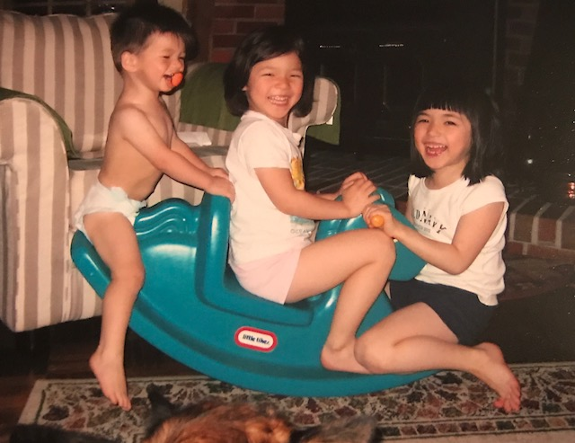 The+Chung+siblings+having+a+blast+while+trying+to+fit+all+three+of+them+on+one+rocking+horse.