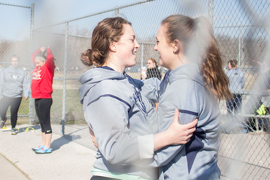 Embracing before beginning their competition, throwers Abigail Green and Mackenzie Schierding hug on Wednesday. Green just recently earned and accepted an appointment to throw at West Point Military Academy.
